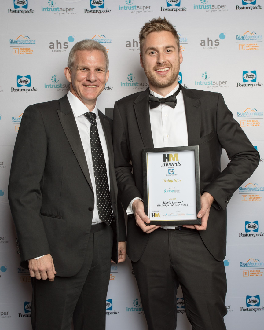 Marty Lamont of ibis Budget Hotels NSW/ACT  joint winner of the Rising Star award presented by Darryl Whittaker of sponsor Intrust Super