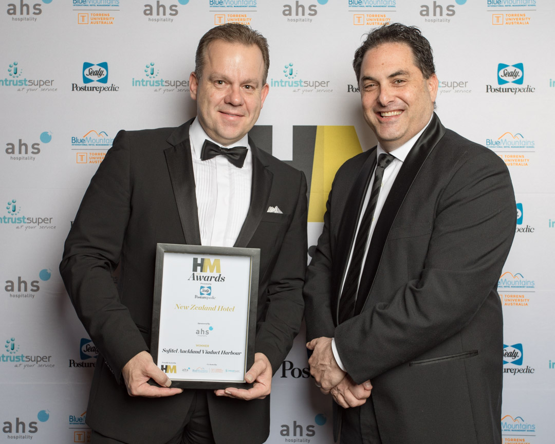 Jeremy Healy of Sofitel Auckland Viaduct Harbour joint winners of the New Zealand Hotel award presented by Steven Tochner of sponsors AHS Hospitality