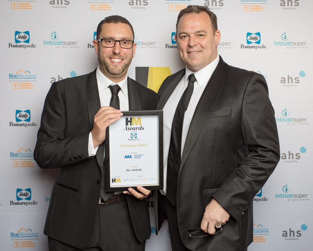 Jeremy Samuals recieves the Economy Property Award won by Ibis Adelaide and presented by Richard Munro of sponsors Accommodation Association of Australia