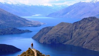 A tourist looking over Wanaka waters.