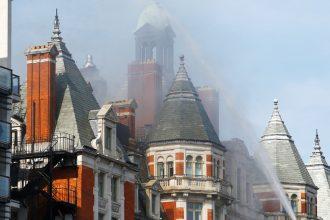 Photo of the Mandarin Oriental Hotel, London, ablaze on fire.
