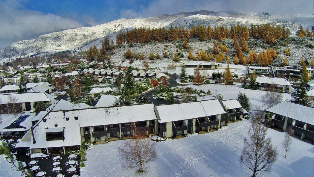 Snowy Wanaka mills surround the Edgewater accommodation site.