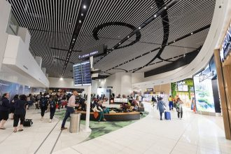 Visitors arrive at Auckland International Airport.