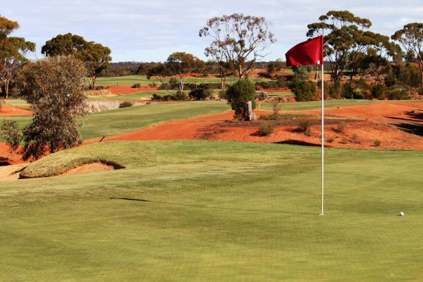 Flagstick rises from the Kalgoorlie Golf Course putting green.