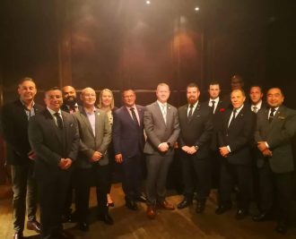 The Les Clefs d'Or team poses for a photo with their new Honorary Member.
