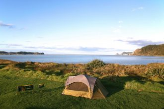 Tent above the sand dunes in coastal New Zealand.