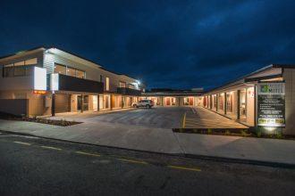 Pedlars Motel exterior at night.