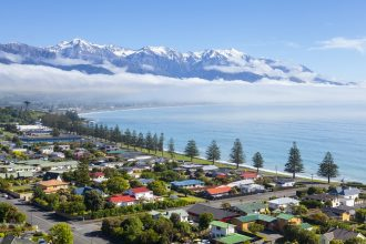 Elevated view over the picturesque coastal town of Kaikoura, South Island, New Zealand.