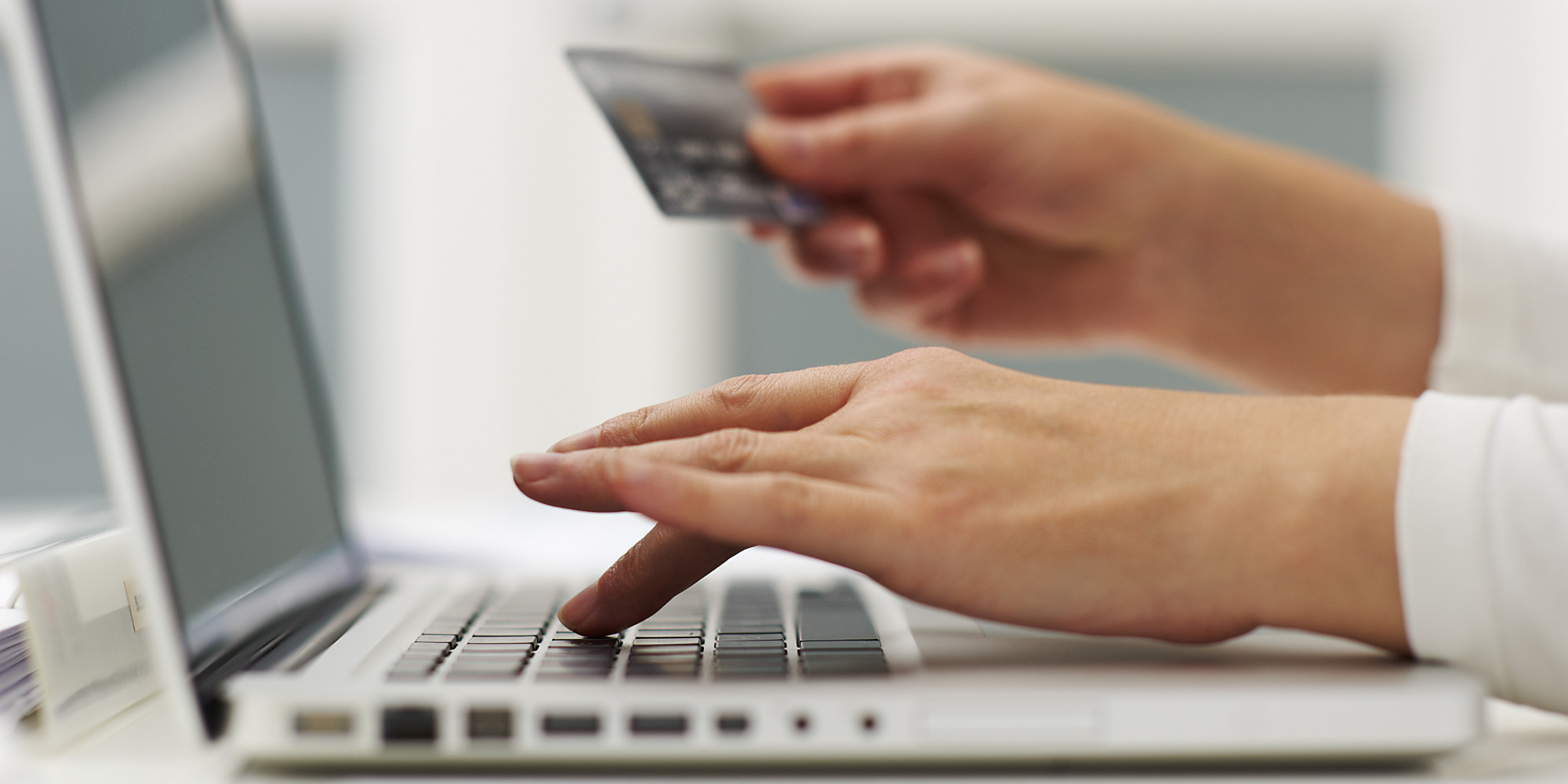 some hands buying online with a credit card