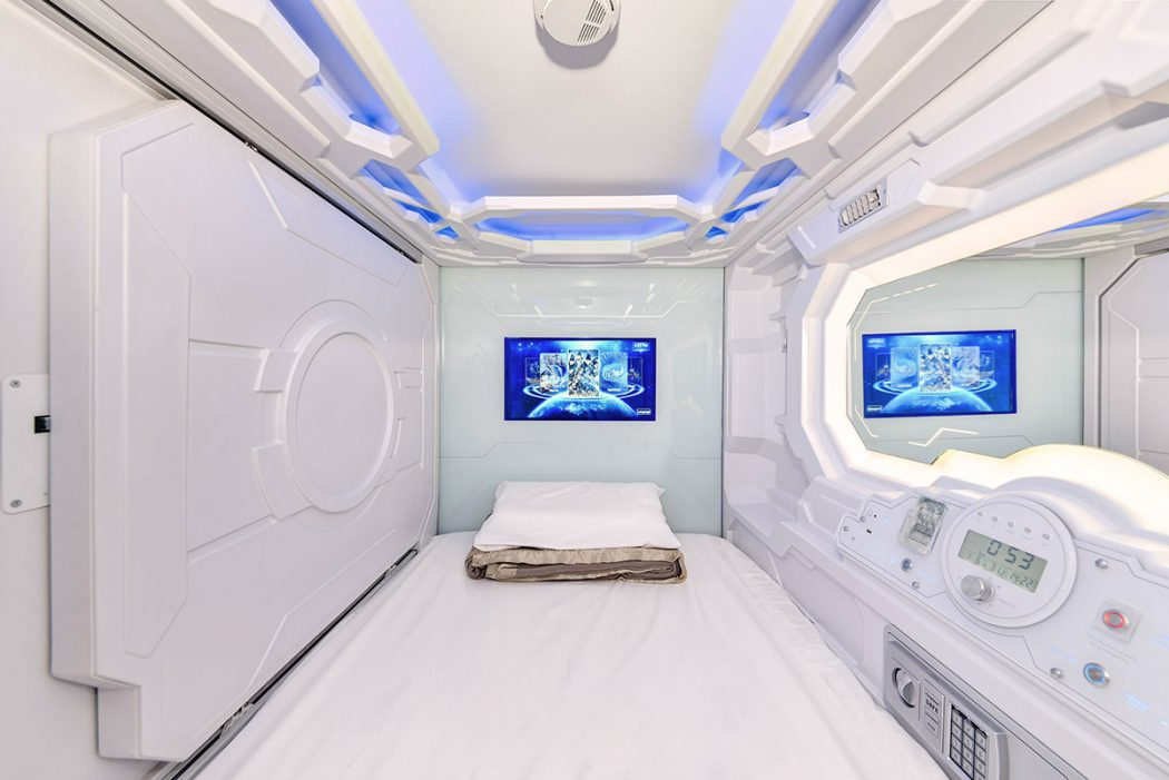 Capsule hotel room with TV