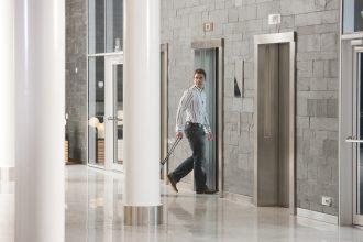 Man walking into an elevator