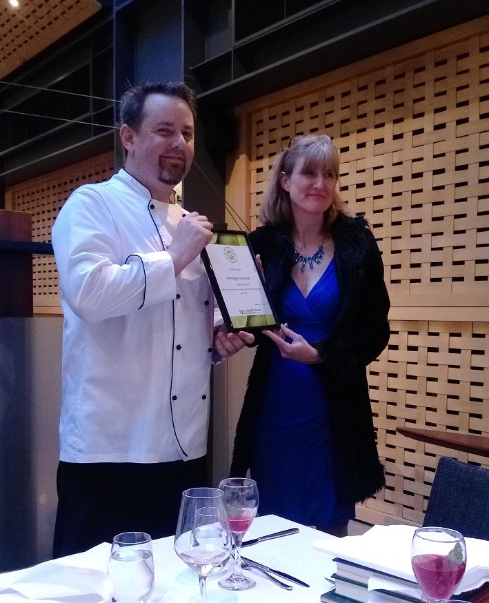 Gerrard O'Keefe, executive chef at Heritage Auckland being presented Vegan Certification by Julia Clements, president of the New Zealand Vegetarian Society
