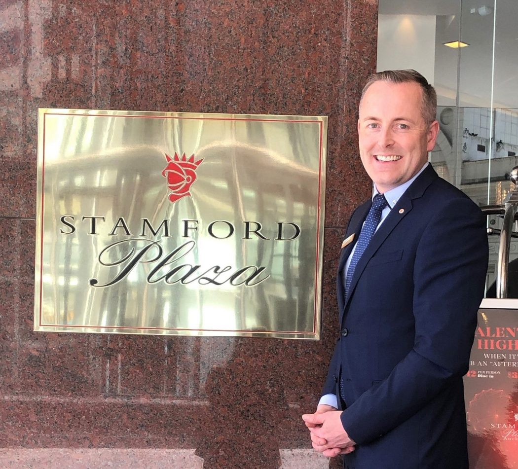 Clinton Farley stands outside Stamford Plaza Auckland.