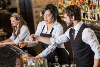 Hospitality workers at bar.