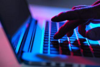 Laptop hand typing