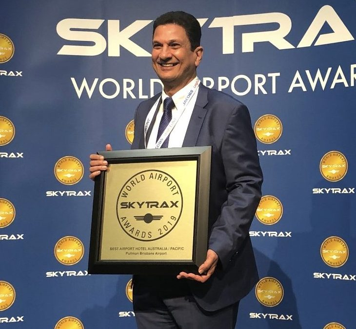 Kirshan Tangri, BAC executive general manager assets, accepting the award on behalf of Pullman Brisbane Airport.