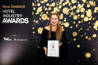 Annalise Stewart receives her Hotel Industry Award in 2018.
