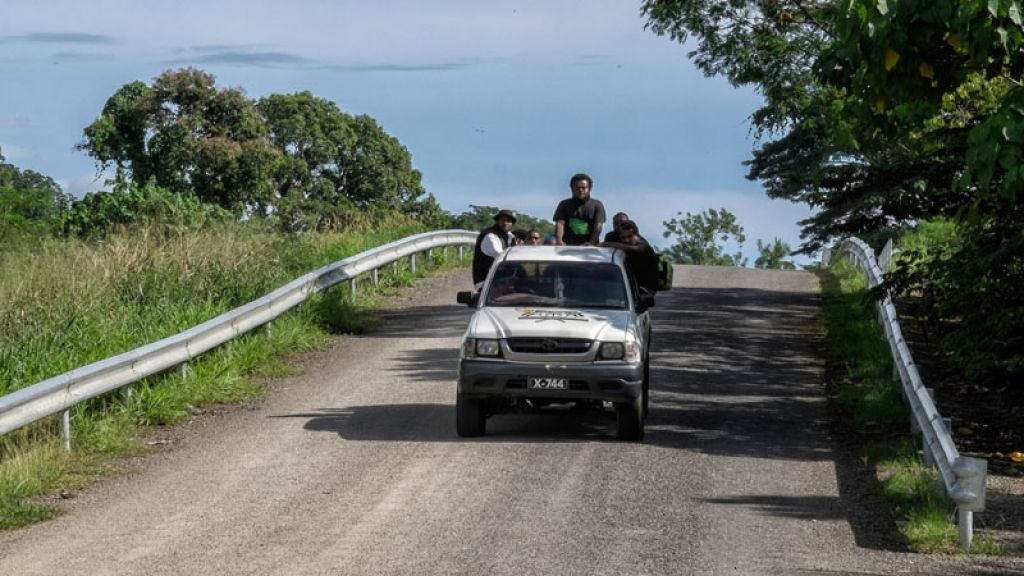 Locals ride a truck in the Solomon Islands.