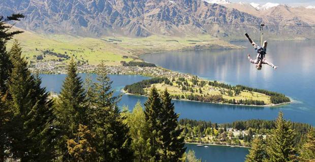 Tourist ziplining in New Zealand.